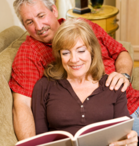 Elder couple reading book